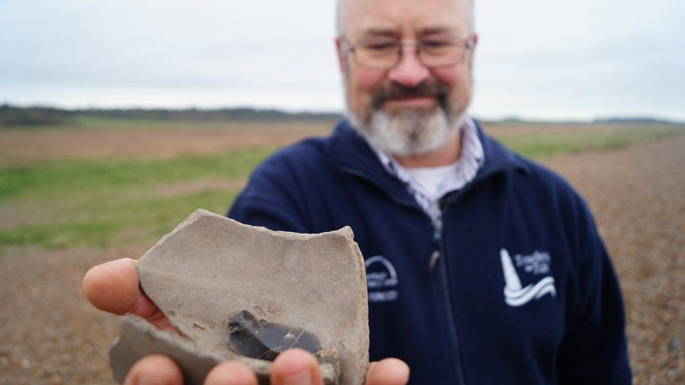 Bill Jenman with pottery from Dunwich