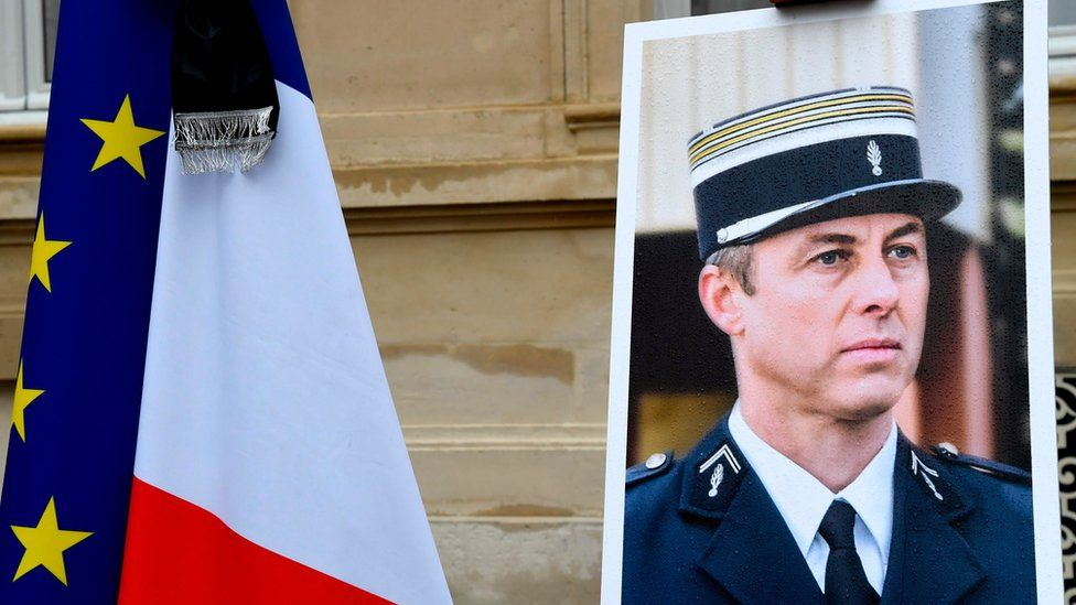 A portrait of French Lieutenant-Colonel Arnaud Beltrame is pictured during a minute of silence