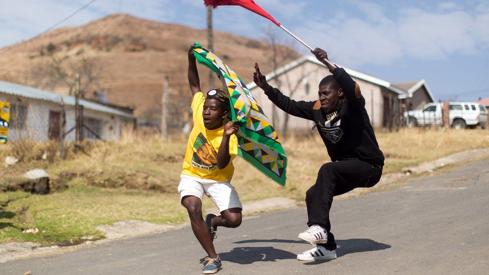 African National Congress ( ANC) and South African Communist Party ( SACP) supporters dance and sing in celebration at Wembezi township near Estcourt some 215 kilometres west of Durban on August 3, 2016.
