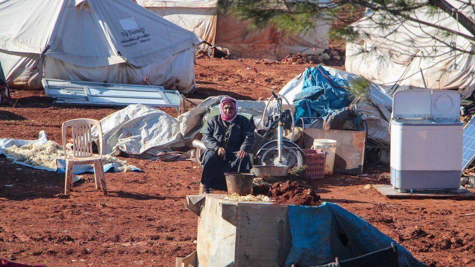 A displaced Syrian man sits in a camp near the Bab al-Hawa border crossing with Turkey. Photo: 9 February 2020