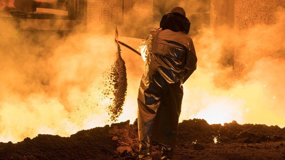 A Steel worker is seen at the blast furnace of German steel manufacturer Salzgitter AG in Salzgitter, Germany