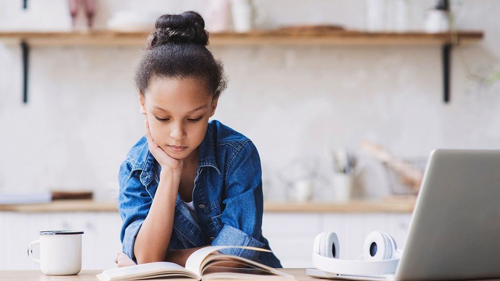 Girl studying in kitchen