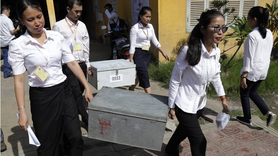 Cambodian National Election Committee (NEC) officials carry election boxes as they prepare for national elections in Phnom Penh, Cambodia, 28 July 2018