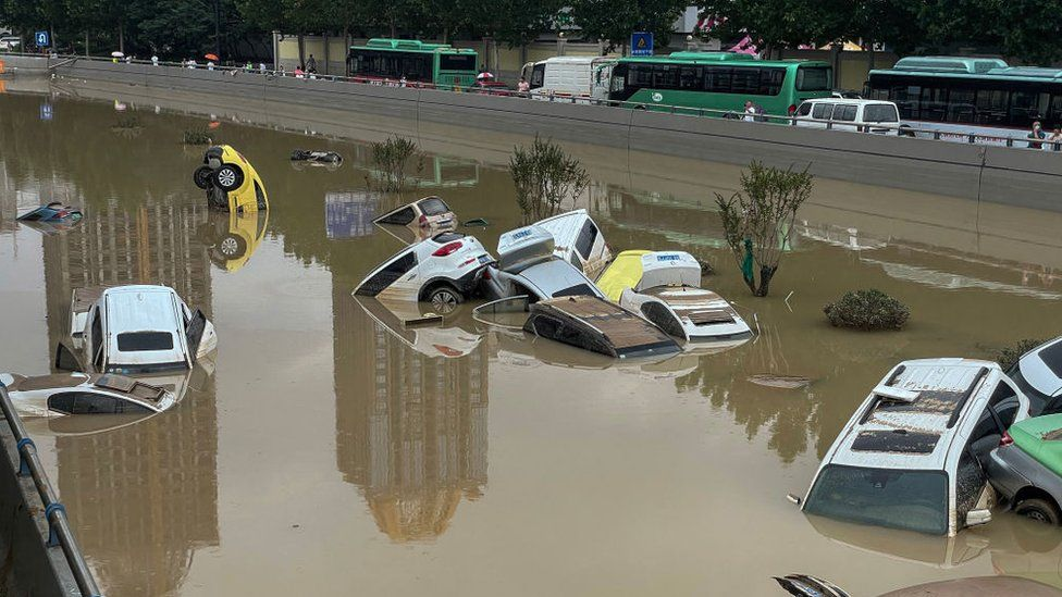 Cars sit in floodwaters after heavy rains hit the city of Zhengzhou in China's central Henan province on July 21, 2021.