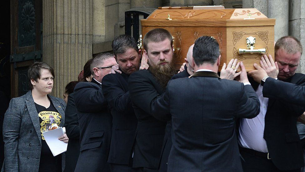 Sara Canning behind the coffin of Lyra McKee