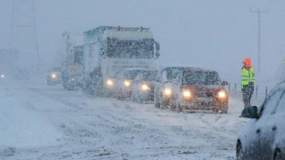 Vehicles in snow in Cumbria