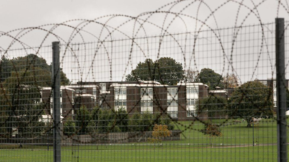 Barb wire surrounds the Defence College of Logistics at Deepcut on October 26, 2005
