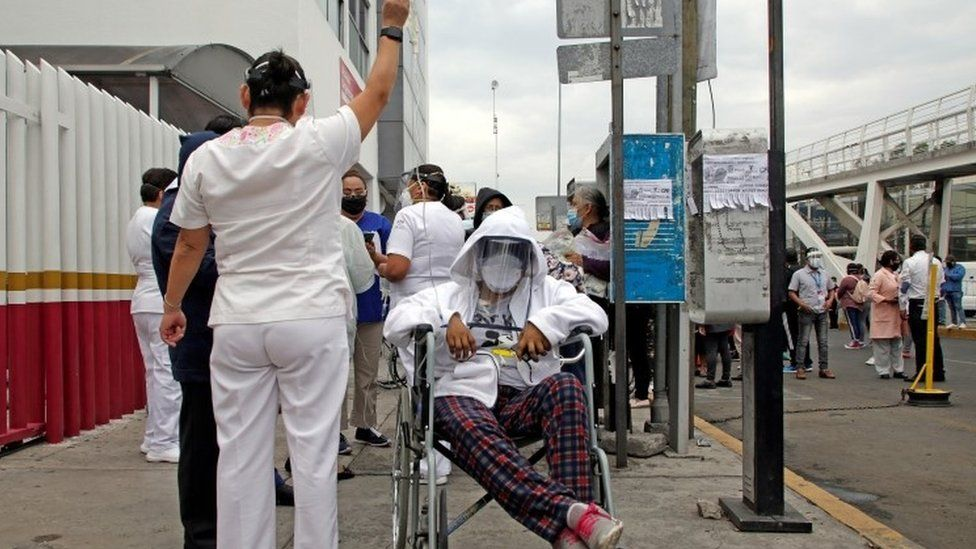 Patients are evacuated from a hospital after hearing the seismic alert in Puebla Mexico