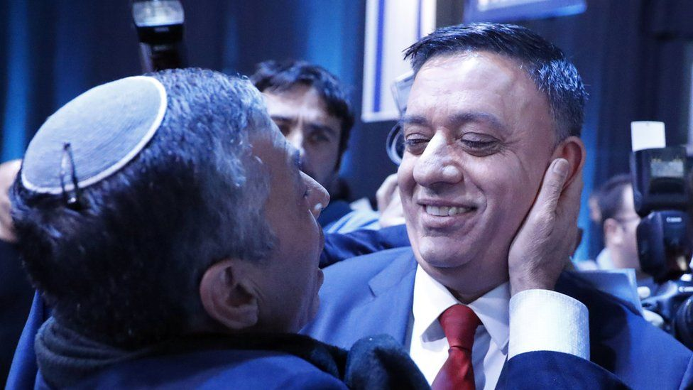 Avi Gabbay (R), chairman of Israel's Labour Party, meets with a supporter during a party conference in the coastal city of Tel Aviv on 10 January 2019.