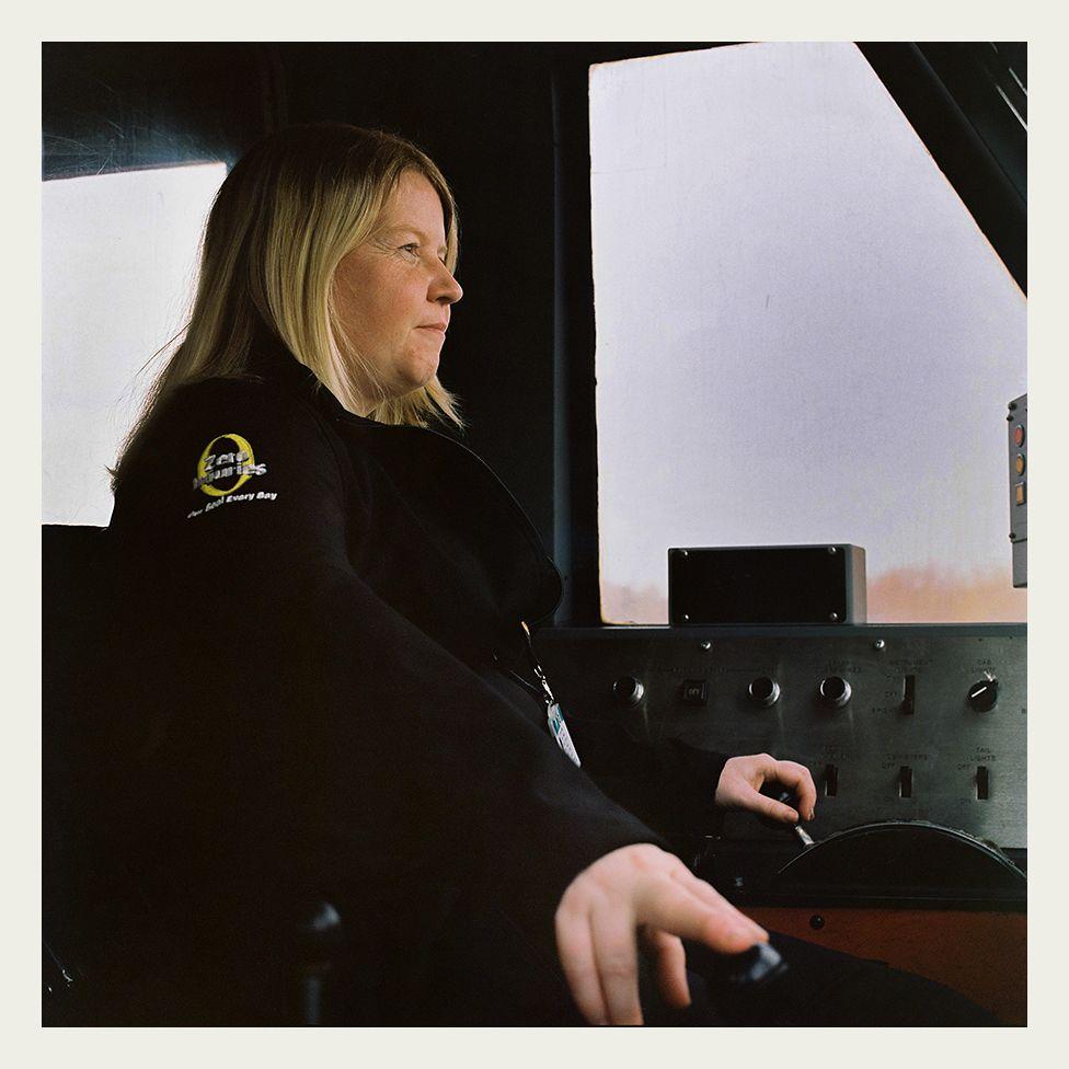 Heather Waugh drives a Class 90 locomotive.