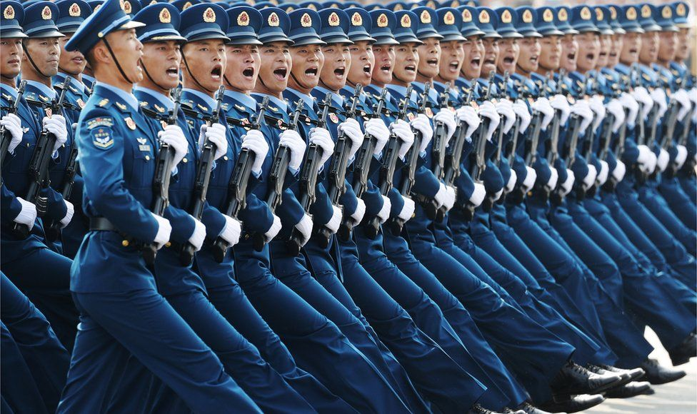 Troops march in blue uniform in Tiananmen Square on 1 October 2019.