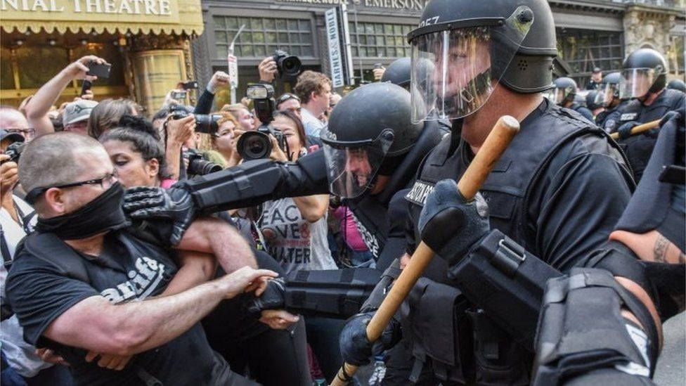 Police in Boston clash with protesters against a conservative rally, 19 August 2017