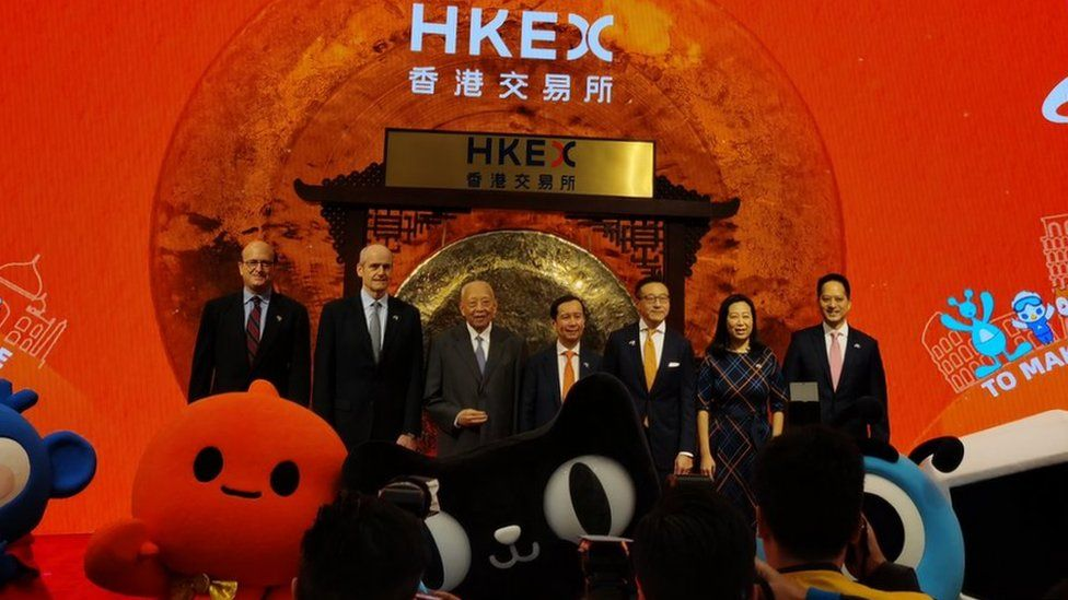 Alibaba chairman Daniel Zhang in the centre of a picture of Alibaba executives adn Chinese officials at the Hong Kong stock exchange