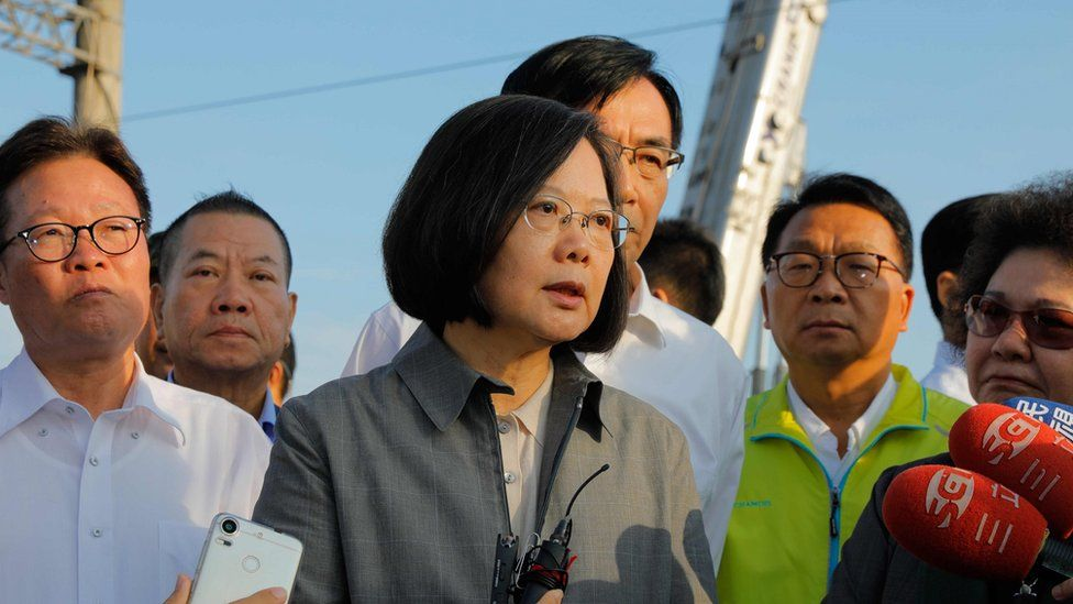 """Taiwan""""s President Tsai Ing-wen (C) speaks after a briefing at Xinma station in Taiwan's northeastern Yilan county"""