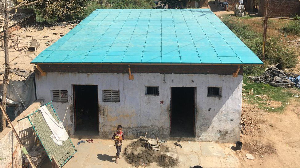 Large blue roof on stone building