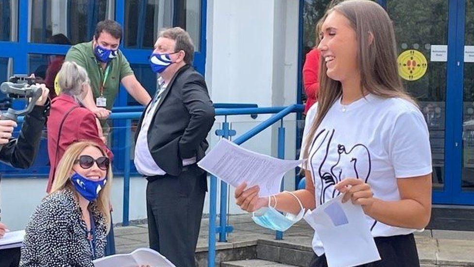 A student celebrating her results on Tuesday