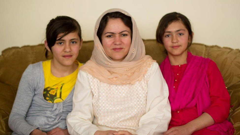 Koofi with her two daughters in 2012