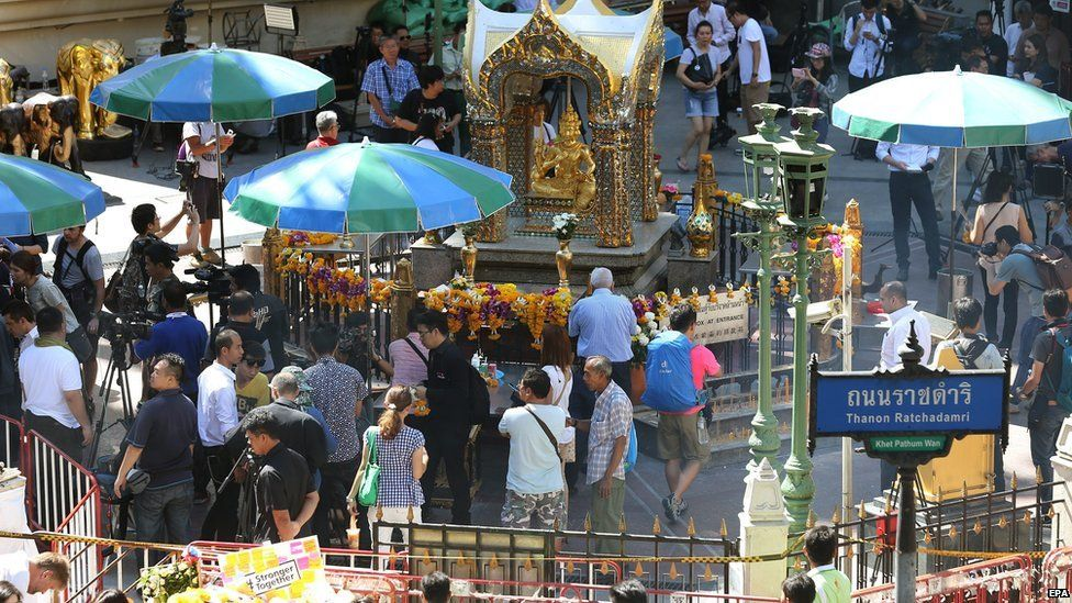 Visitors and journalists at shrine