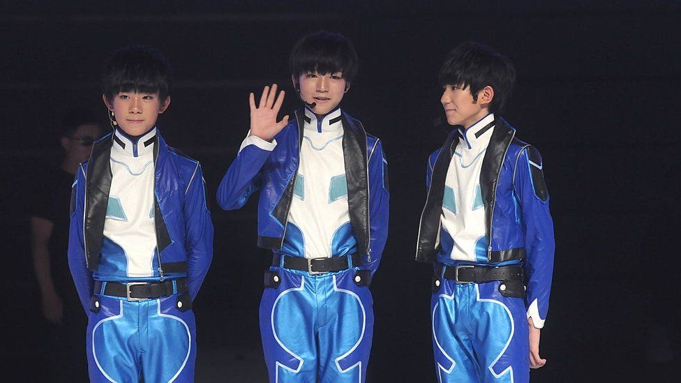 Chinese youngest boy group TF-BOYS attend commercial activity on Monday August 4,2014 in Shanghai,China