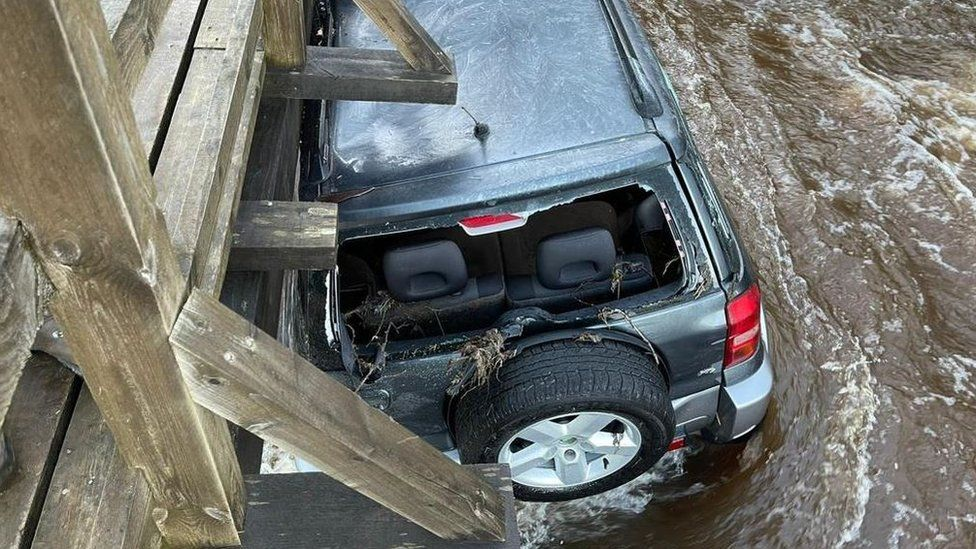 Car in flood waters