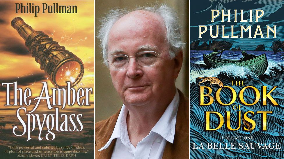 Philip Pullman between the book jackets for The Amber Skyglass and La Belle Sauvage