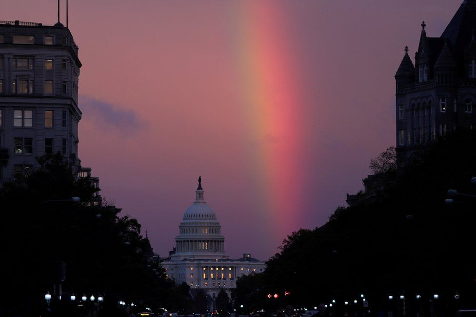 A rainbow forms over the US Capitol as evening sets on mid-term election day in Washington on 6 November 2018