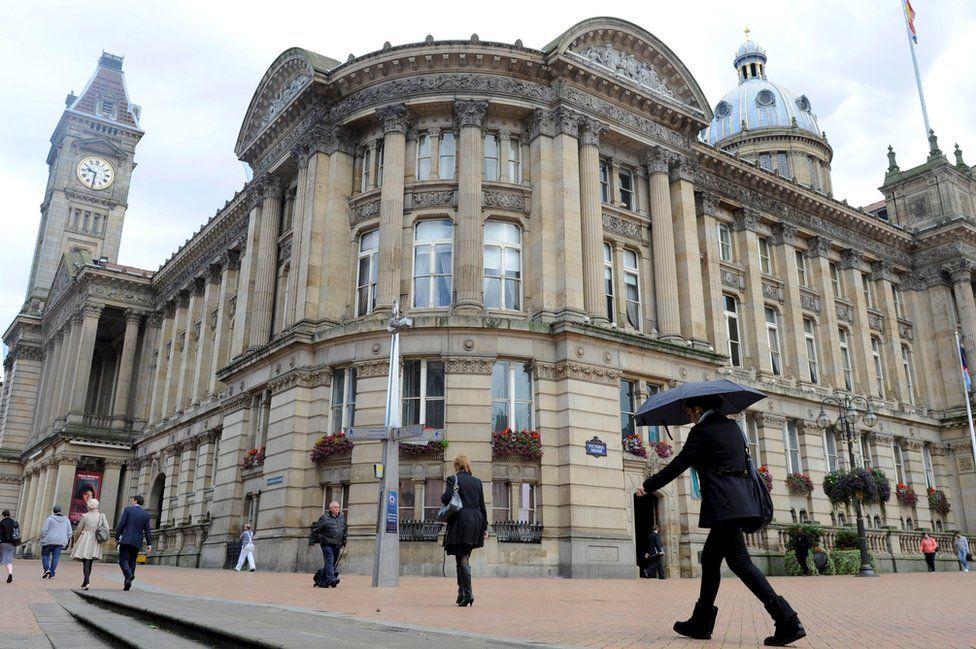 People walk past Birmingham's Council House
