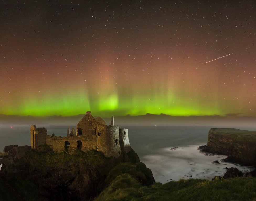 The aurora borealis above Dunluce Castle in County Antrim