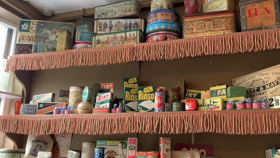 Shop shelves with old packages.