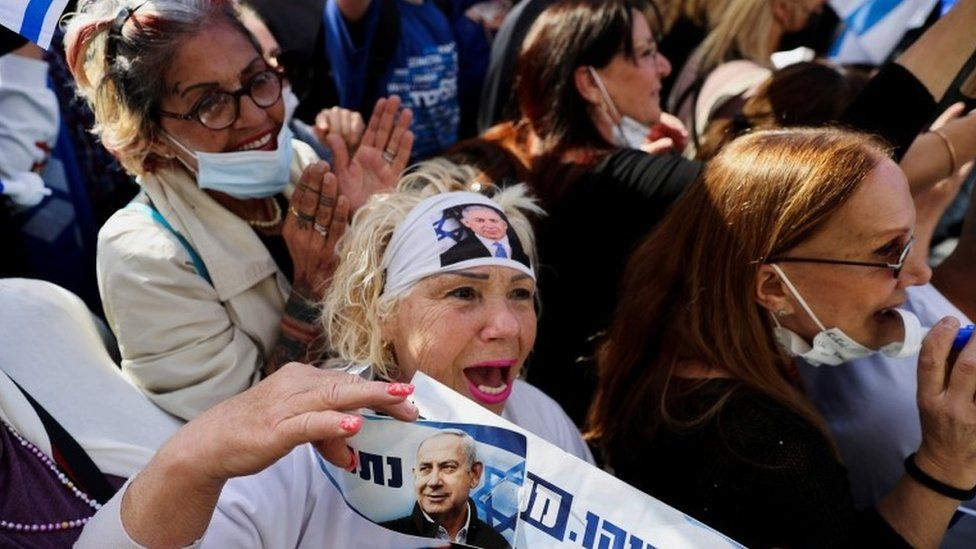 A supporter of Israeli Prime Minister Benjamin Netanyahu shouts slogans during a rally as his corruption trial resumes in Jerusalem (5 April 2021)