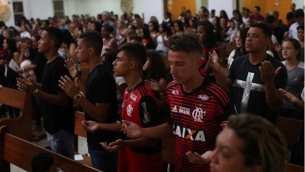 Mourners at a memorial mass, Rio de Janeiro, 8 February 2019