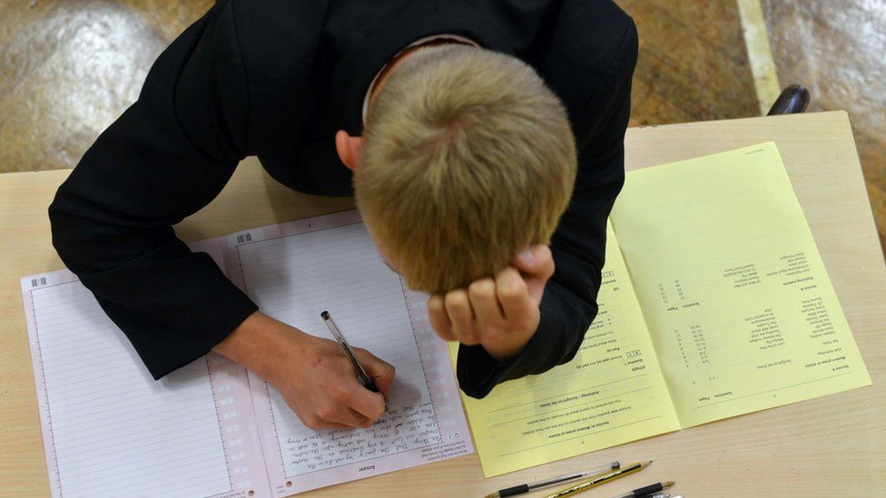 Stressed boy sitting an exam