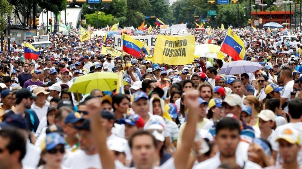 Opponents to Venezuelan President Nicolas Maduro march during a rally in Caracas on September 1, 2016.