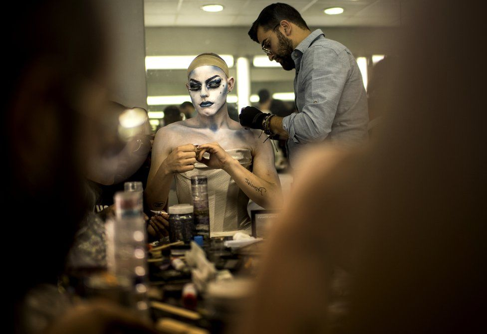 Elias has help from a make-up artist as he transforms into Melanie Coxxx