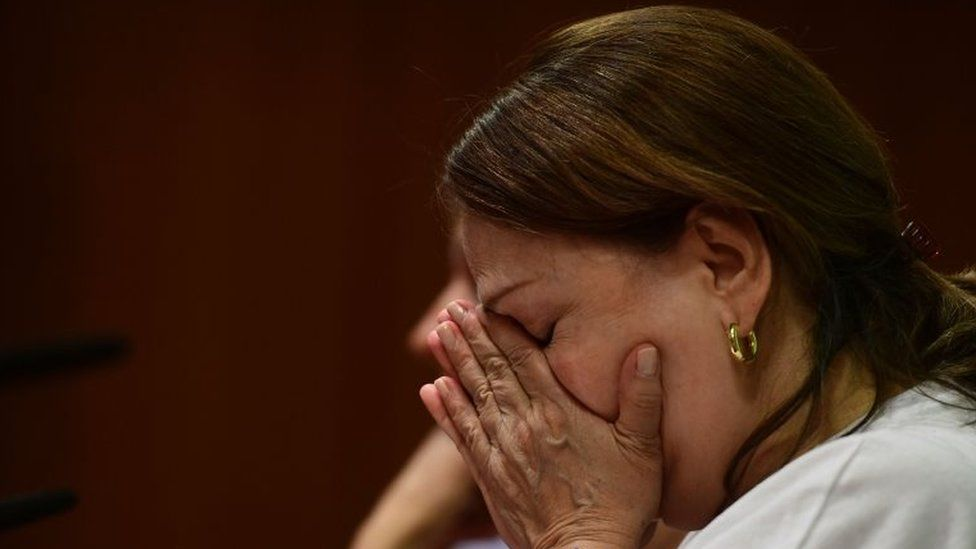 Wife of prominent opposition leader and mayor of Caracas Antonio Jose Ledezma, Mitzy Capriles, wipes her eyes during a press conference in madrid on August 1, 2017 after her husband was arrested overnight by the Venezuelan intelligence service (Sebin) in Venuezuela a day after a vote to choose a much-condemned assembly that supersedes parliamen