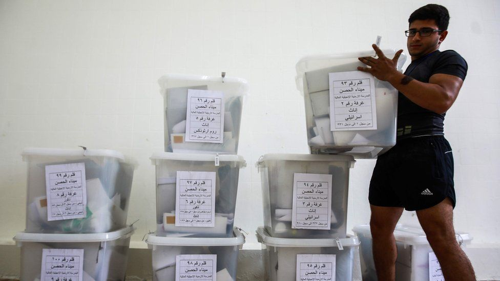 A Lebanese government employee sorts sealed electoral ballot box containing new ballots marked for the various religious groups according to Lebanese confessional voting rules, at a government office in the capital Beirut on May 5, 2018,