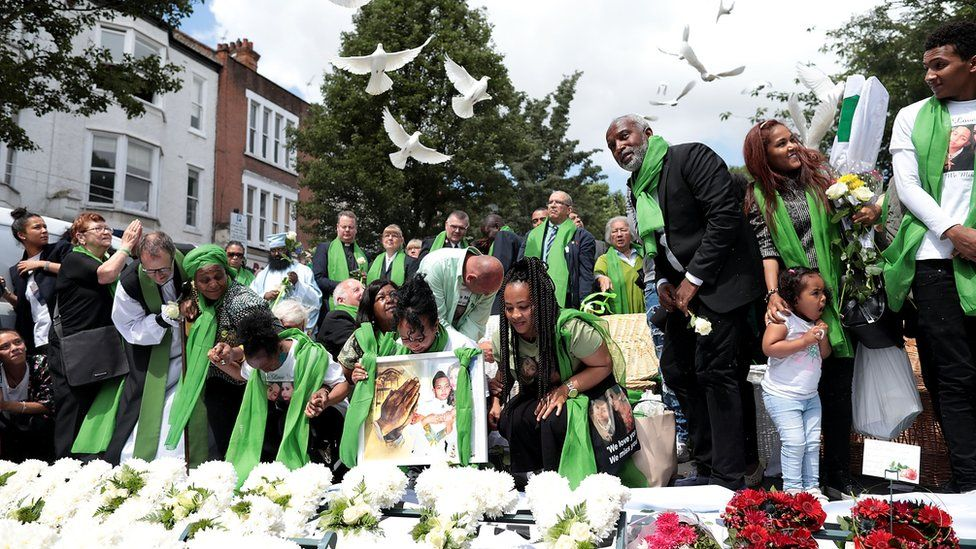 Doves being released outside the Grenfell memorial service