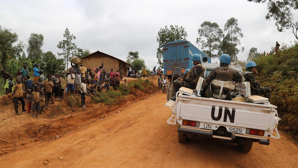 Moroccan soldiers from the UN mission in DRC ride in a vehicle as they patrol in the violence-torn Djugu territory in eastern DRC