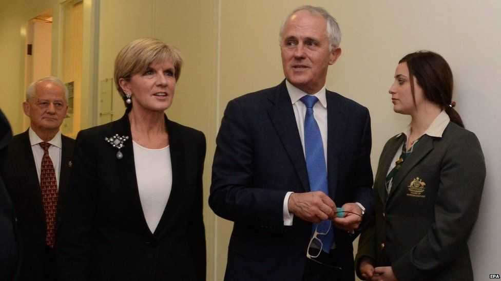 Malcolm Turnbull (C) leaves the Australian Federal Liberal party room with Julie Bishop (left) after winning the leadership, at Australian Parliament House, 14 September 2015.