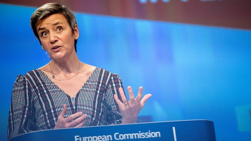 Margrethe Vestager stands at a European Commission podium