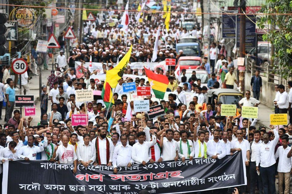 Activists in Assam take part in a protest against the a bill that seeks to give Hindu migrants more rights.