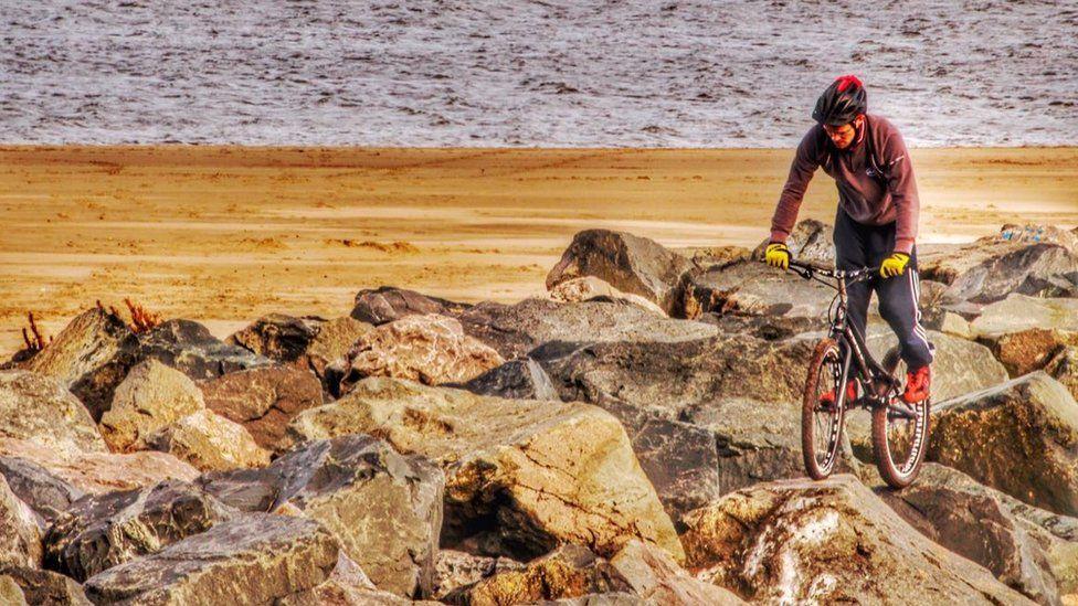 Cyclist on the beach
