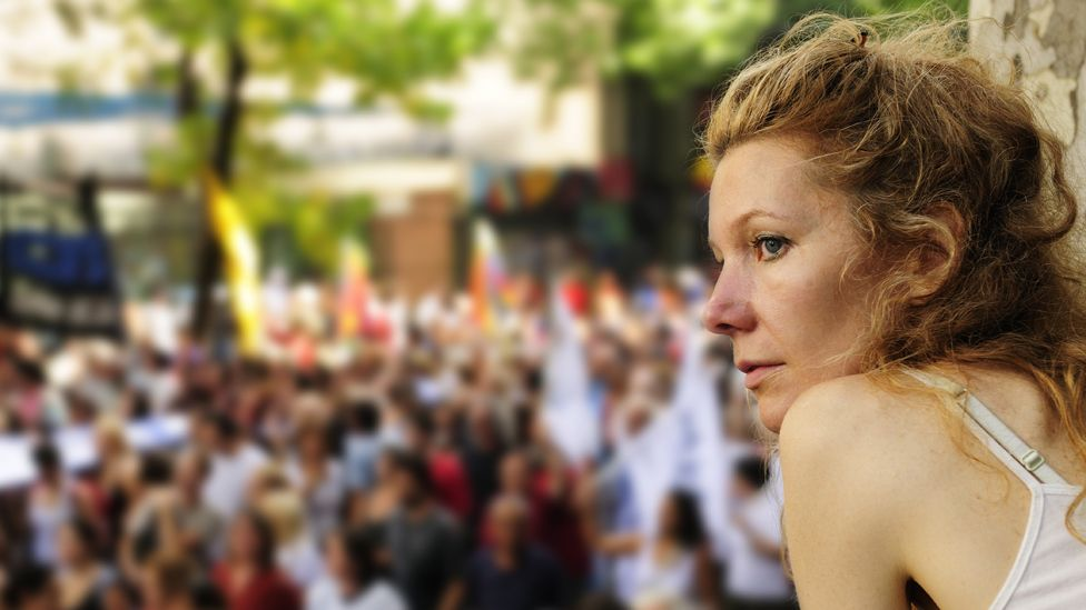 A woman watches a demonstration