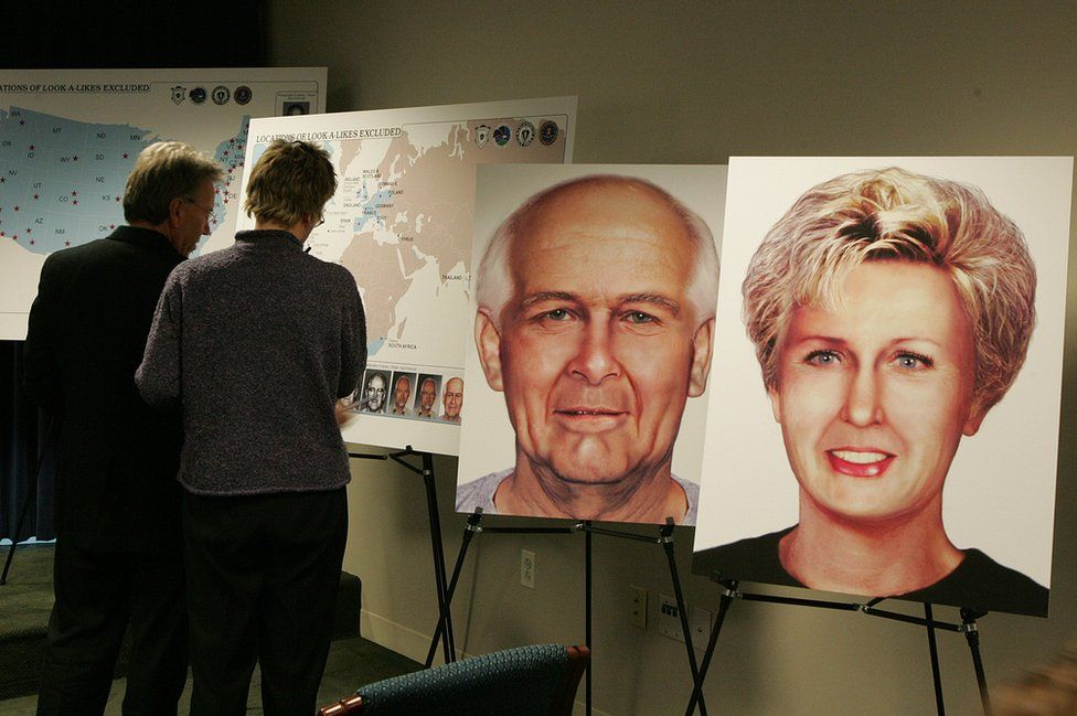 A display board shows two pictures of what Whitey Bulger and Catherine Greig were believed to look like in 2004