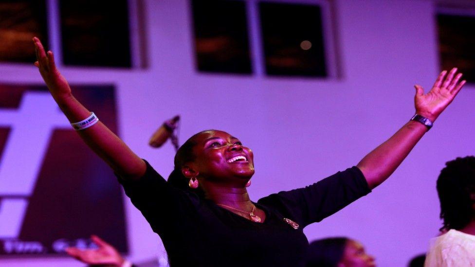 A worshipper expresses joy during church service at Living Faith Church in Abuja, Nigeria - Sunday 22 March 2020
