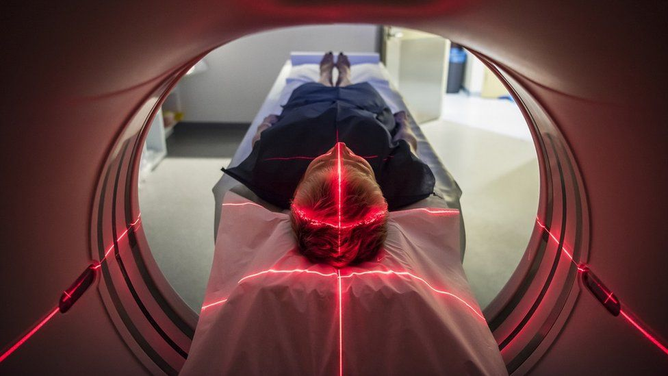 Patient going through a brain medical scanner in a hospital