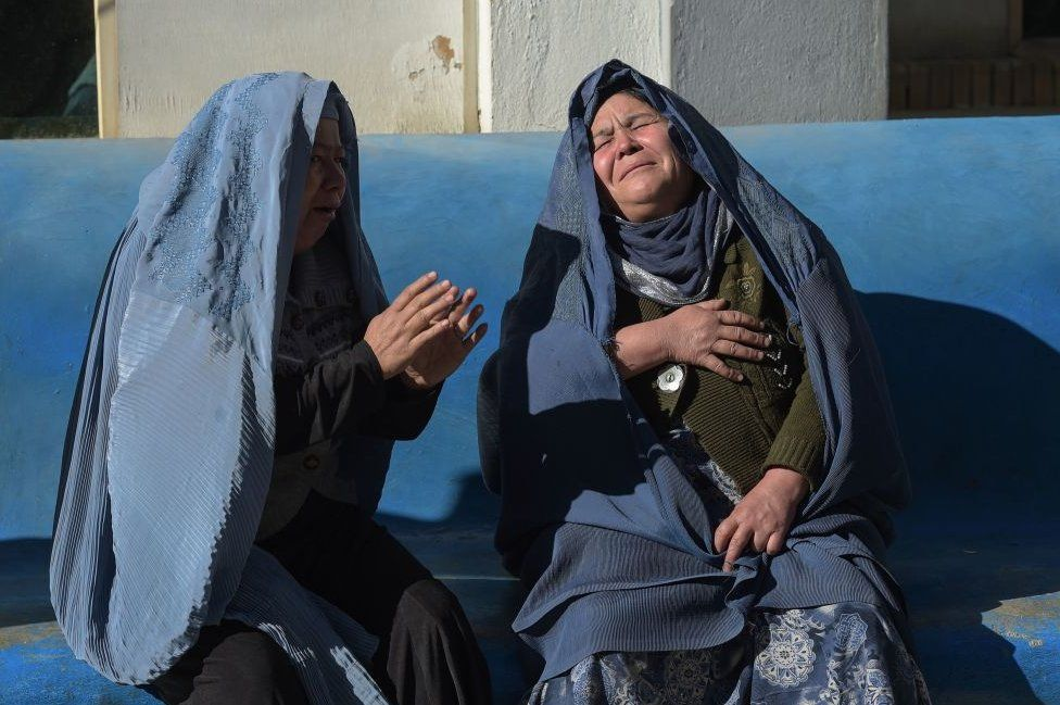 Two Afghan women weep for their relatives at a hospital following explosions at a Shiite cultural centre in Kabul, 2017