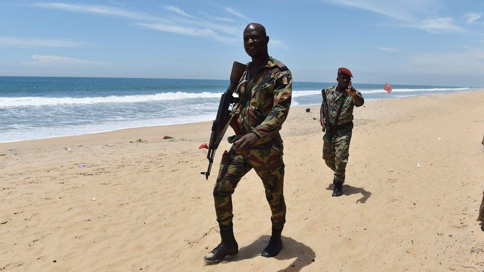 Soldiers patrol the beach in Ivory Coast
