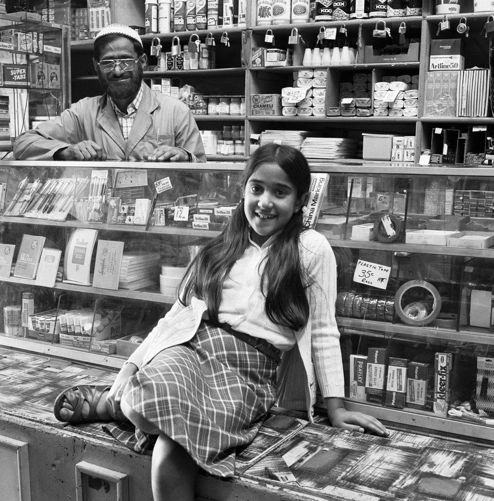 Ozzie Docrat with his daughter Nassima in his shop before its destruction in 1977.