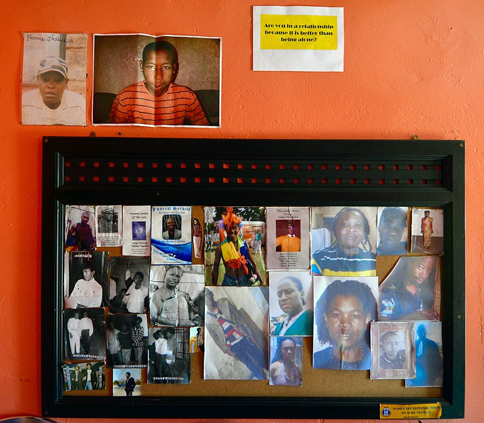 Remembrance wall containing photos of activists